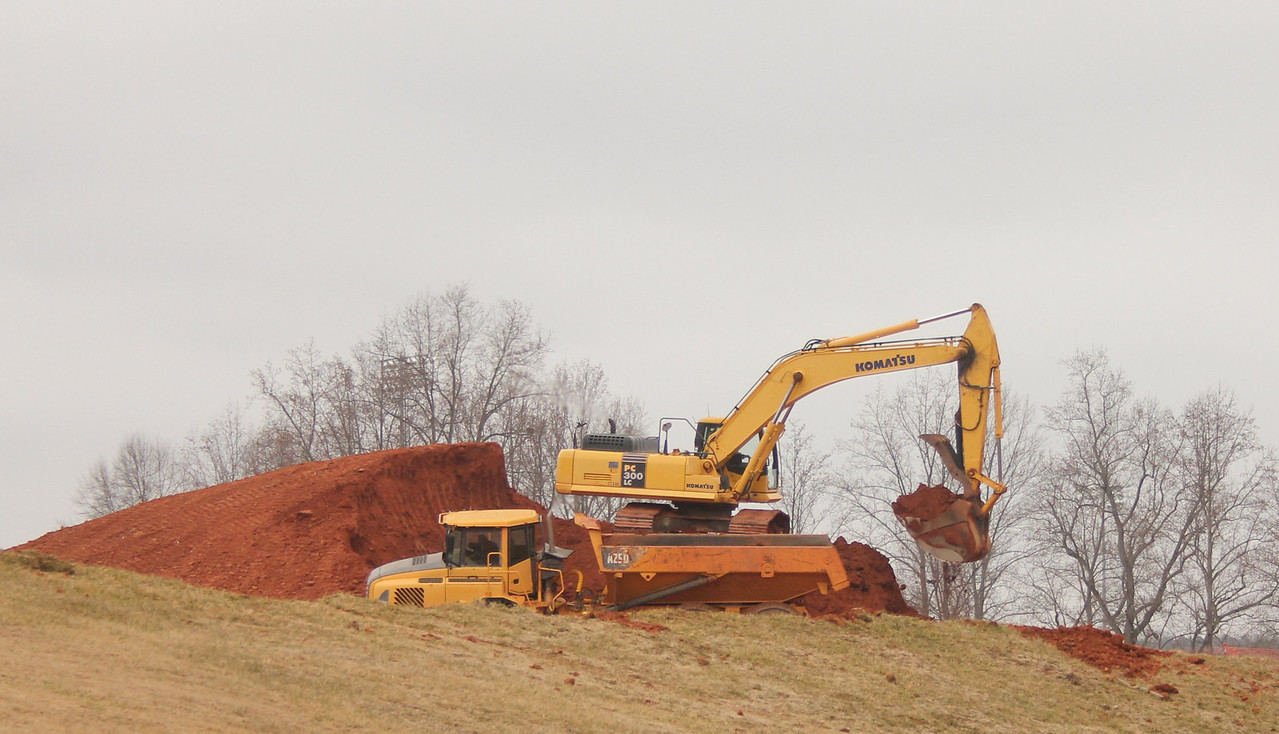 The grading company hard at work on clearing land for the Tucker Student Center.