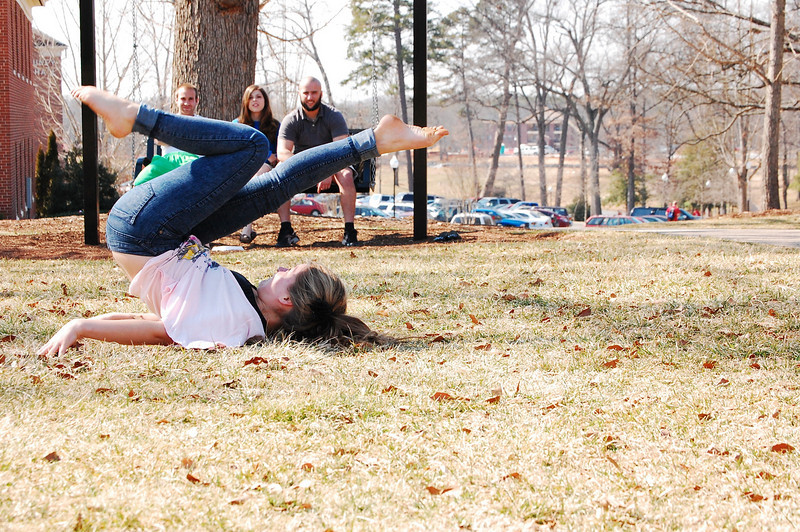 Students soak up the sun and enjoy the warm weather on the Quad