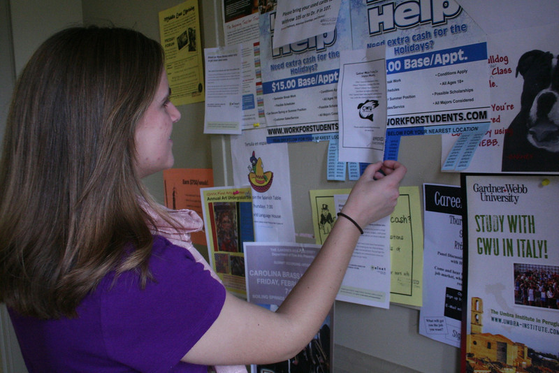 Student, Anna Hulsey, checks the bulletin board inside of Craig Hall for upcoming events.