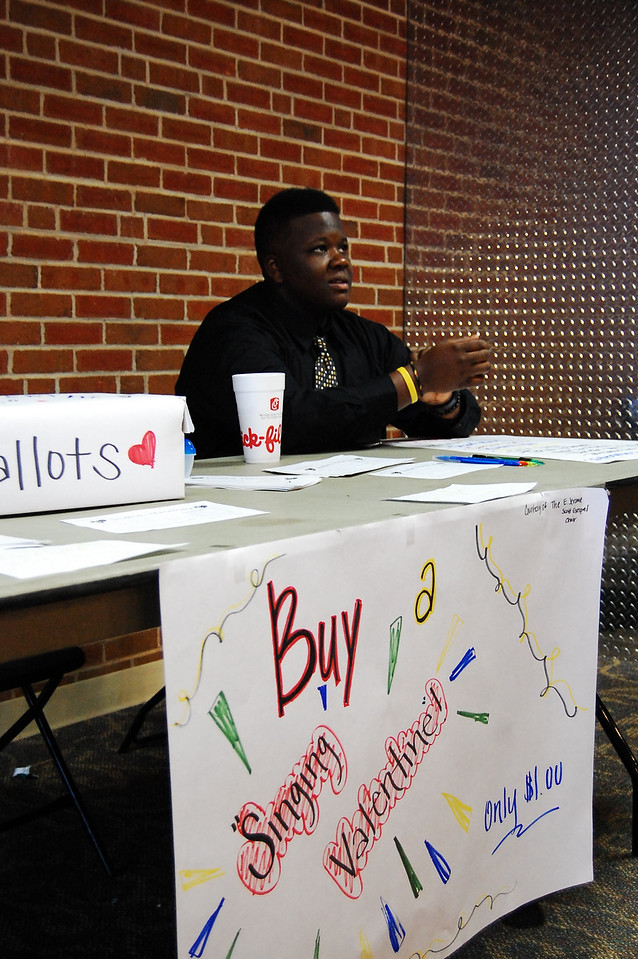 """Chad Roseboro manages the table for the Gospel Choir's """"Singing Valentine"""" Fundraiser."""