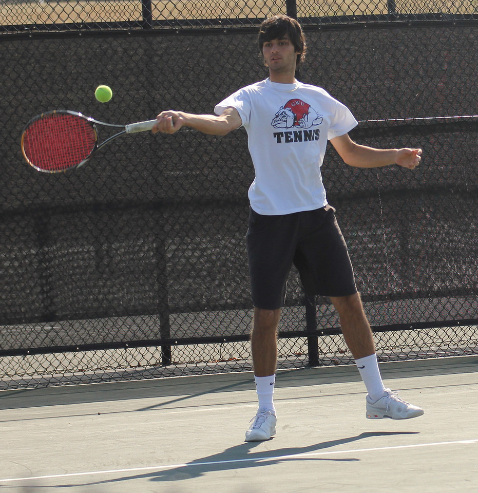 Freshman Korhan Ates is matched against a member of the Lees-McRae squad.