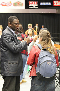 Smaratan's Feet founder Manny Ohonme speaks to students following Dimensions on Tuesday, February 1, 2011