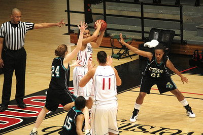 Latroya Pope (23) looks to pass to Sandra Vaitkute (11).