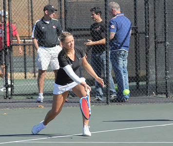 Jenny Lunde plays tennis against Elon on February 19th.