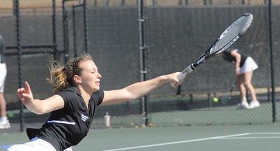 Erica White chases a tennis ball in her match against Elon.