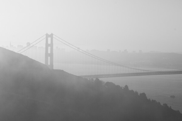 Foggy morning sunrise at the Golden Gate Bridge. We had hoped that there would be low fog below the bridge but ended with a failed attempt as the fog came in high and covered it up completely. This was the best we could do.