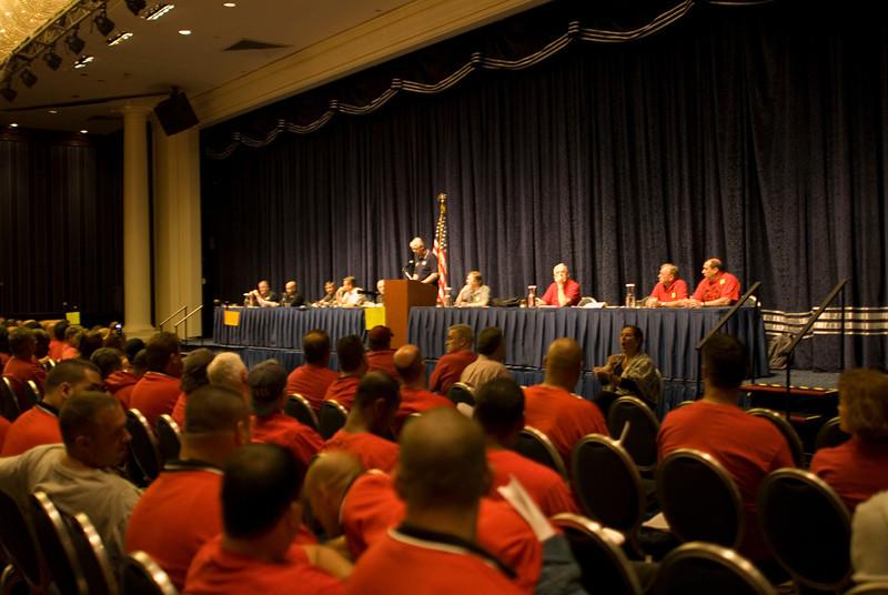 The Membership Meeting begins with Secretary Jim Trainor at the podium.