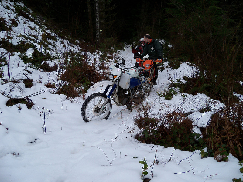 On an old trail.. Scott checking out my KTM 200