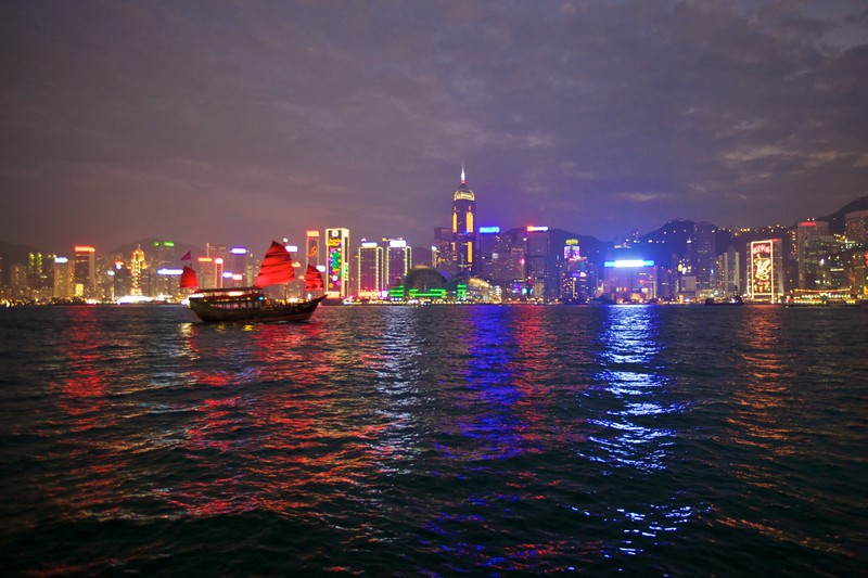 A faux-Chinese junk crosses Victoria Harbour in front of the Hong Kong skyline.