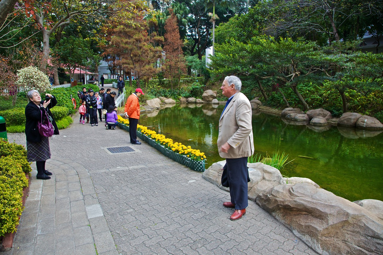 Taking photographs in Hong Kong Park.