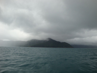 As we finally neared our island, we were disturbed to see it cloaked in ominous rain-clouds.