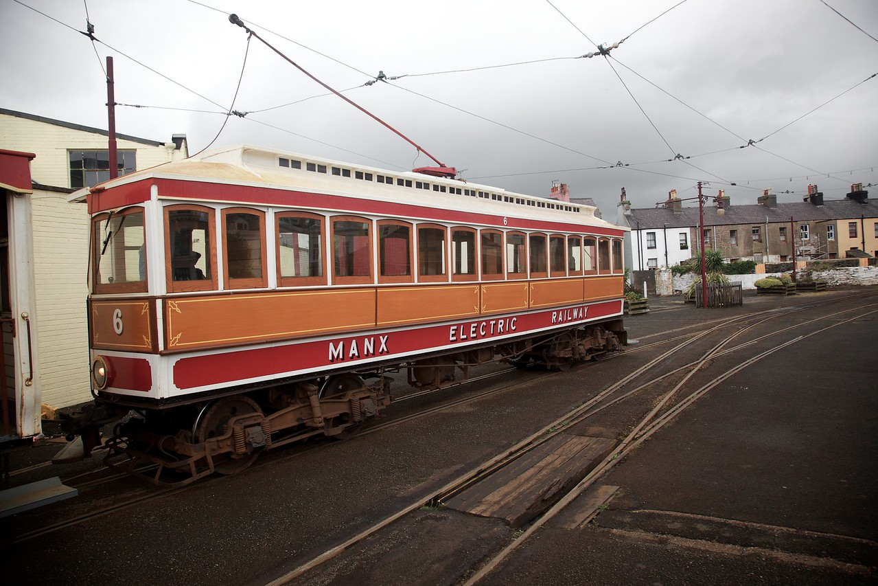The tram, having disonnected from its toast-rack trailer, moves from one line to the other at Ramsey so that it can return south to Douglas. The trailer was moved releasing its brake and letting gravity carry it past the points so that it can be reconnected to the (now) rear of the tram.