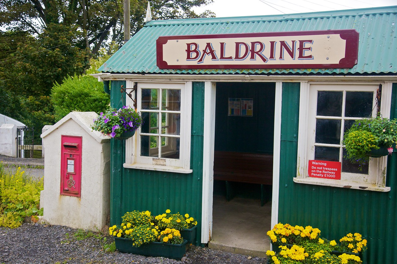 The Baldrine tram (sorry, 'Electric Railway') stop on the line from Douglas to Ramsey. Many of the stops were decorated with bloomng flowers.