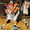 Mine: Patriot Logan Shipley plays tough defense against the Alices' Nick Klumpp in first half action Saturday night.