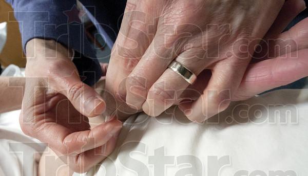 Healing Hands: Dr. Stienstra performs acupuncture on breast cancer survivor Debby Trierweiler.