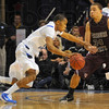 Brush off: As Dwayne Lathan drives to the basket he brushes aside the arm of Bear Kyle Weems.