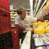 Stock up: Baesler's Market's employee Dustin Bryant stocks produce after today's rush.