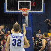 It's in: Jake Kelly(behind Aaron Carter) hits the winning free throw with just 0.6 seconds on the clock.