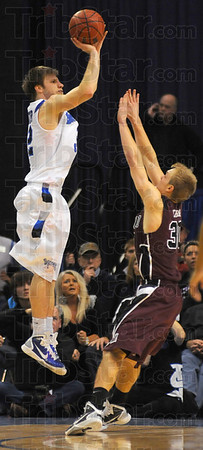 Comeback: After a slow first half, Aaron Carter came back to hit big shots in the second agaisnt Missouri State. Here he shoots over Bear defender Nathan Scheer.