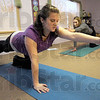 Reach: Brittany Harrison receives prenatal yoga instruction Tuesday evening from Samantha Brinkeroff from Paris,Ill.