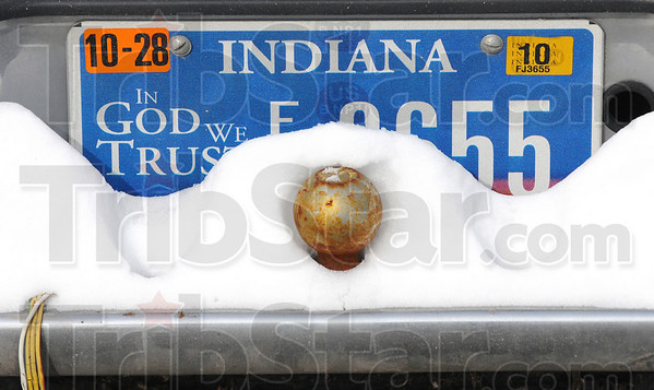 Piling up: Snow from earlier this week obscures part of a license plate on a truck parked in downtown Terre Haute.