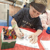 Color Time: Five-year-old West Vigo resident Christian Jones colors a picture of Benjamin Franklin.