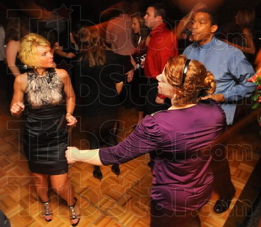 Dancin' the night away: New Year's revelers dance at Odessey, the fundraiser for Junior Achievement held Friday night in the Ohio Building.