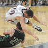 Up and over: North's #20 Logan Shipley goes over the top of West Vigo's #20 Cade Lindsey during a battle for a loose ball Friday niight at the North gym.