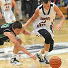 Double twenties: West Vigo's #20 Cade Lindsey chases a loose ball with North's #20 Logan Shipley.l