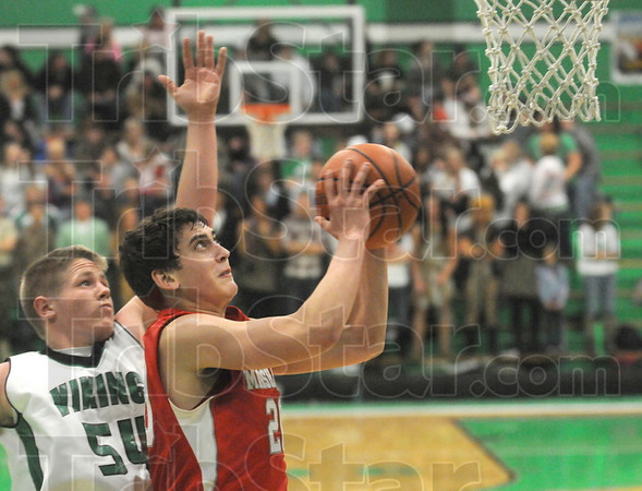 Driven: Marshall's #20, Andrew Davidson drives the ball to the basket against West Vigo's #54, Adrien Corenflos during first half play.