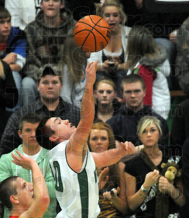Runner: West Vigo's #20, Cade Lindsey throws up a runner down the baseline during first half action against Marshall at the Green Dome Friday night.