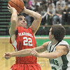 Shot: Marshall's #22, Jacob Duncan takes a short-range jumpshot during first half action at West Vigo Friday night.