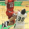 "Flop: West Vigo defender #30, Cody Thornton attempts to draw a foul by ""flopping"" after Marshall's #22, Jacob Duncan drives past him and scores Friday night."