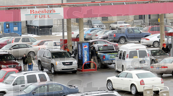 Fill-up: Motorists formed lines at Baesler's Market to get gas as part of a fundraiser for the United Way Friday afternoon.