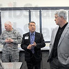 Tour: Dr. Richard Baker (center) leads a group on a tour of the facilities of the Aviation Technology program at Indiana State University. At right is Indiana Homeland Security director Joe Wainscott.