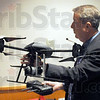 Unmanned: Dr. Richard Baker shows one of the unmanned aircraft available for use by Homeland Security.