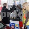 "High five: Brad Chaney and Julie Henricks ""high five"" after pumping gas at Baesler's Market for the United Way."