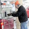Service: Fred Nation cleans the rear window of a vehicle he's servicing at Baesler's Market as part of a United Way fundraiser Friday afternoon.