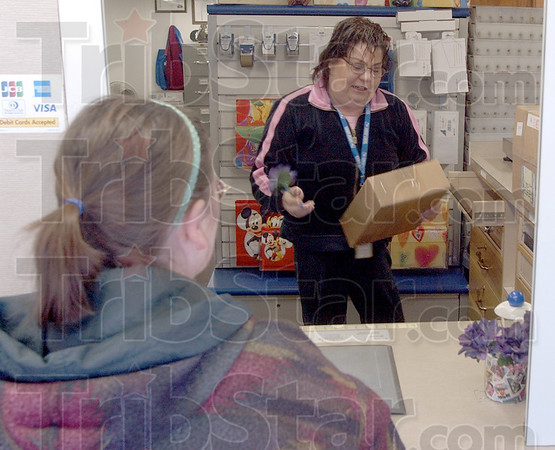 Personal service: Debbbie Vaughn is waiting on by Prairieton Postmaster Denise Edwards Friday afternoon.