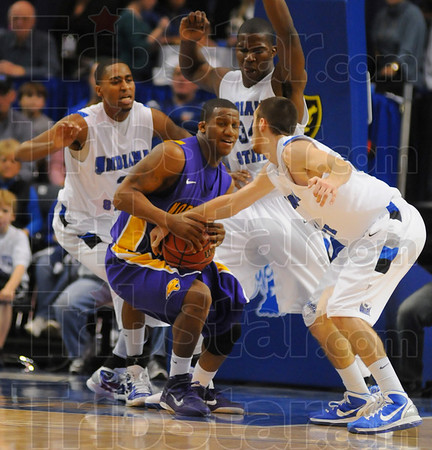 Kwadzo Ahelegbe finds himself surrounded by Sycamores Jake Odum, right, Myles Walker center and Steve McWhorter. left.