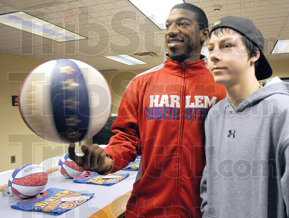 Photo: Buckets Blake spins a ball on his finger and poses with  Dalton Pryor at the Salvation Army Friday afternoon.