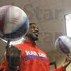 Double spin: Buckets Blakes, player for the Harlem Globetrotters visits the Salvation Army and displayed some of his skills to recipients of game tickets and memorabilia.