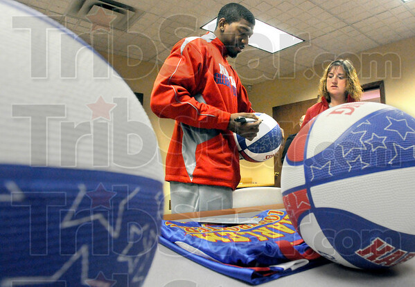 Autograph: Buckets Blake autographs a basketball for Pam Chilton and her family at the Salvation Army Friday afternoon.