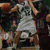 Drive and dish: West Vigo's #12 Jordan House dishes the ball as he drives down the lane against Riverton Parke's#40 Cody Vauters.