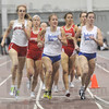 Mile run: The women's mile run was congested going into the final laps but Illinois State's Aisha Praught red jersey (sandwiched between ISU runners Kacie Klem andKelsie Slater) broke away at the end to win the event.