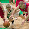 Loose Ball:Viking's Adrien Corenflos fights Warrior's Riley Sunderman for a loose ball in first quarter action at West Vigo.