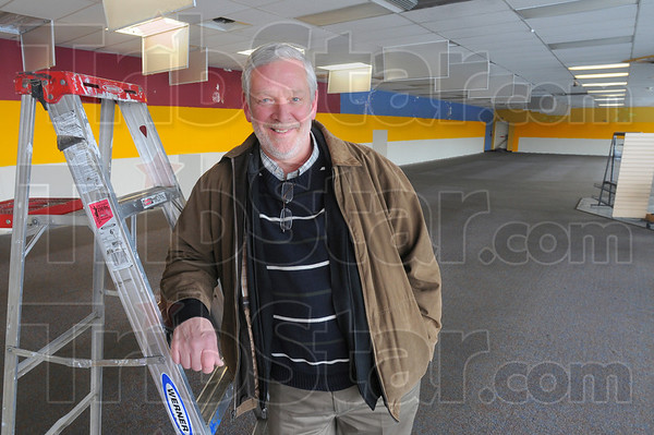 More space: Bill Tennis stands in the old Blockbuster Video on South Third street, soon to be another reatil outlet for Goodwill.