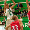 Hot Hand: Ryan Crowder shots over two warrior defenders in Friday nights game at West Vigo.