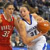 Coming in: Kelsie Cooley(31) moves to the hoop against the defense of Bradley's MacKenzie Westcott.