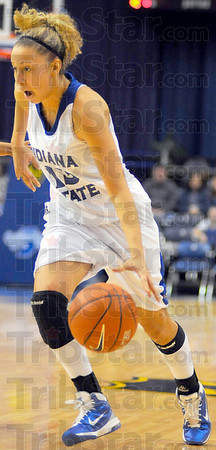 Versatility: Deja Mattox drives into the paint in first half action Saturday in Hulman Center. Mattox shot 3-4 from beyond the arc in the first half.